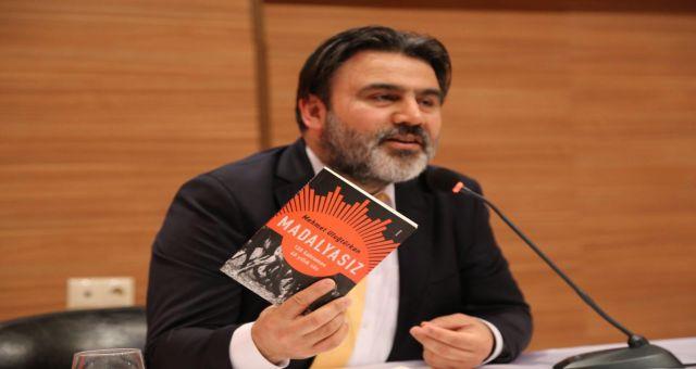 Gazeteci Uluğtürkan'ın ''Madalyasız'' Romanı Bilimsel Dergide